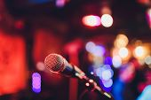 Microphone On A Stand Ready For Live Music Performance Or Karaoke Night With Soft Bokeh Lights And P poster