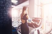 The Girl Sets Up A Suitable Program On The Treadmill. The Athlete Selects A Suitable Program For Run poster