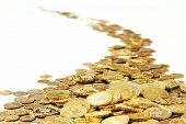 foto of golden coin  - many of gold coins making curved path - JPG