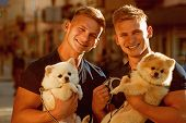 Dogs Make Life Better. Happy Twins With Muscular Look. Spitz Dogs Love The Company Of Their Family.  poster