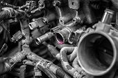 Close-up Of Engine Failure: Pink Antifreeze Flows From The Engine Pipes Of An Old Car poster