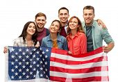 patriotism, citizenship and friendship concept - group of smiling friends with american flag over wh poster