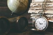 Travel Or Adventure Concept Background. Pocket Watch, Binoculars, Globe And Stack Of Books On The Ad poster