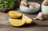 Cut Lemon And Garlic On Wooden Table. Cough Remedies poster