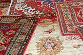 picture of iranian  - collection of antique oriental carpets expensive on display in the antiques boutique - JPG