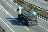 image of tank truck  - Large semi tanker truck rolling on highway - JPG