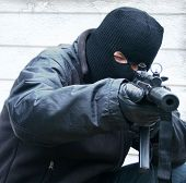 stock photo of terrorist  - terrorist about to shoot  - JPG