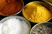 foto of haldi  - A container holding a variety of condiments and spices used in cooking - JPG