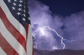 picture of waving american flag  - American flag displayed during an electrical storm - JPG