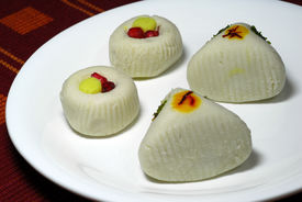 stock photo of mishti  - An isolated shot of White Indian Sweets Mithai decorated with saffron - JPG