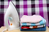 pic of loincloth  - loinclothPile of colorful clothes and electric iron on loincloth background - JPG