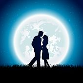 stock photo of enamored  - Enamored couple with Moon on the night sky background - JPG