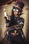 stock photo of dreadlocks  - Portrait of a steampunk man in the ruins - JPG