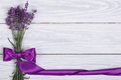 stock photo of violet  - floral frame from flowers of lavender and purple ribbon - JPG