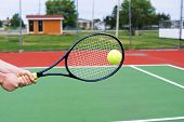 Hitting A Backhand At Tennis