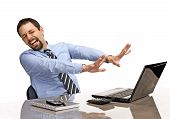stock photo of delinquency  - overwhelmed businessman close his eyes and turned away from the laptop screen  - JPG