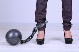 image of ball chain  - Business worker with ball and chain attached to foot - JPG