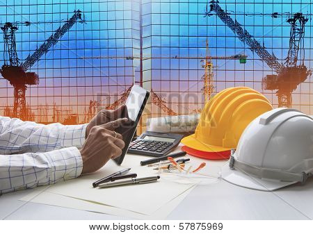 Hand Of Architect Working On Table With Tablet Computer And Working Tool Equipment Against Reflectio poster