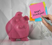 Smart Investment Sticky Note On Piggy Bank 3D Standing Another Fall As Concept
