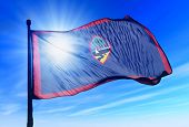 stock photo of guam  - Guam flag waving on the wind on the sky - JPG