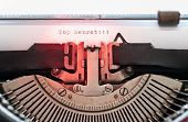 foto of top-secret  - Closeup of paper sheet in vintage typewriter with top secret words