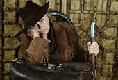 image of bandit  - Mature female Bandit with gun in the wild west - JPG