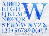stock photo of graffiti  - Alphabet set drawn watercolor blots and stains with a spray blue color - JPG