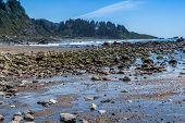 picture of klamath  - Wilson Creek beach Klamath California big rocks formation in water blue sky - JPG