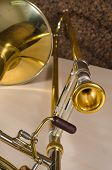 stock photo of trombone  - Trombone against the background of a cork cladded studio wall - JPG