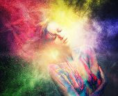 stock photo of explosion  - Woman muse with creative body art and hairdo in colourful powder explosion   - JPG