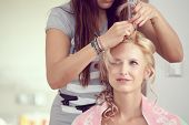 stock photo of dress-making  - hair stylist designer making hairstyle for woman bride in wedding day - JPG