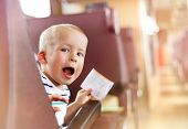 stock photo of passenger train  - Boy travelling in retro train. He is holding train ticket. [[** Note: Shallow depth of field ** Note: Soft Focus at 100%, best at smaller sizes - JPG