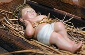 picture of manger  - Statue of baby Jesus in the Manger of the crib at Christmas - JPG
