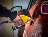 pic of fuel economy  - Hand refilling the car with fuel - JPG