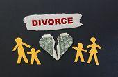 picture of broken hearted  - Paper family and broken money heart with Divorce text - JPG