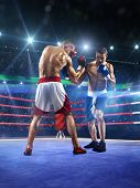 image of sparring  - Two professionl boxers are fighting on the grand arena - JPG