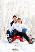 foto of sled  - Mature couple sledding - JPG