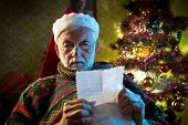 Image of santa claus reading mail.