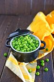 stock photo of green pea  - green peas in bowl and on a table - JPG