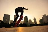 pic of skateboarding  - sihouette  of skateboarder jump skateboarding at sunrise city - JPG