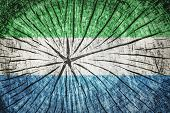 picture of freetown  - Flag of Sierra Leone on cracked wooden texture - JPG