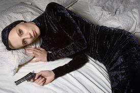 image of girls guns  - girl in black and her gun - JPG