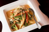 pic of thai food  - Bowl of spicy hot Thai red curry chicken and asian vegetables at local fancy Thai food restaurant - JPG