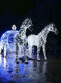 foto of carriage horse  - Decorative carriage with horses decorated with lights - JPG