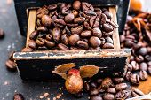 stock photo of wooden box from coffee mill  - Old wooden box with coffee beans inside - JPG