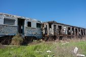foto of caboose  - Old and abandoned passenger train wagons in sunny day - JPG