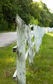 image of stockade  - Old wood stockade between road and field - JPG