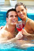 picture of tub  - Young couple relaxing in hot tub - JPG