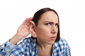 pic of attention  - funny picture of serious woman with one big ear listening attentively and looking at camera - JPG