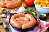 pic of raw chicken sausage  - raw chicken sausages with vegetables on a frying pan - JPG